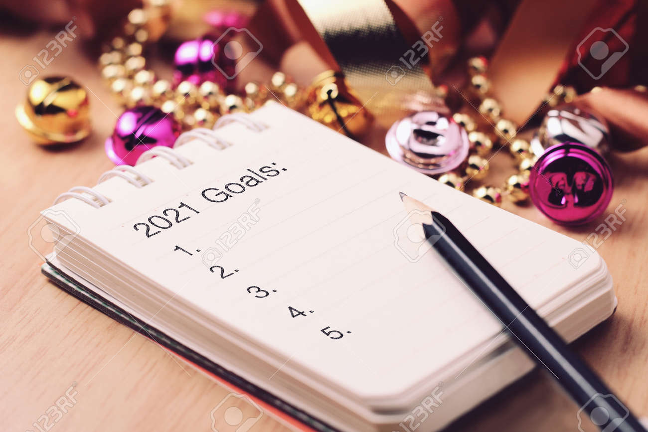 Goals 2021 with beautiful decoration. Discover how setting goals can bring more happiness in your life. - 158667745