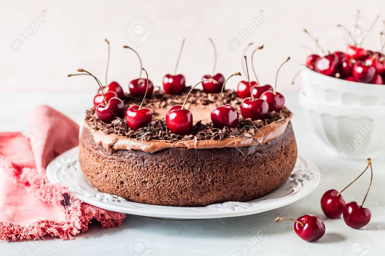 Chocolate Cake Decorated with Chocolate Shavings and Sweet Cherries - 123846221