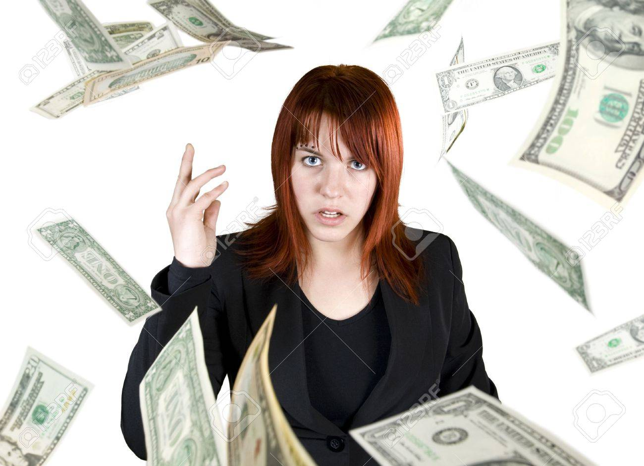 Angry and pretty redhead girl throwing Dollar banknote money towards the camera. Stock Photo - 2319888