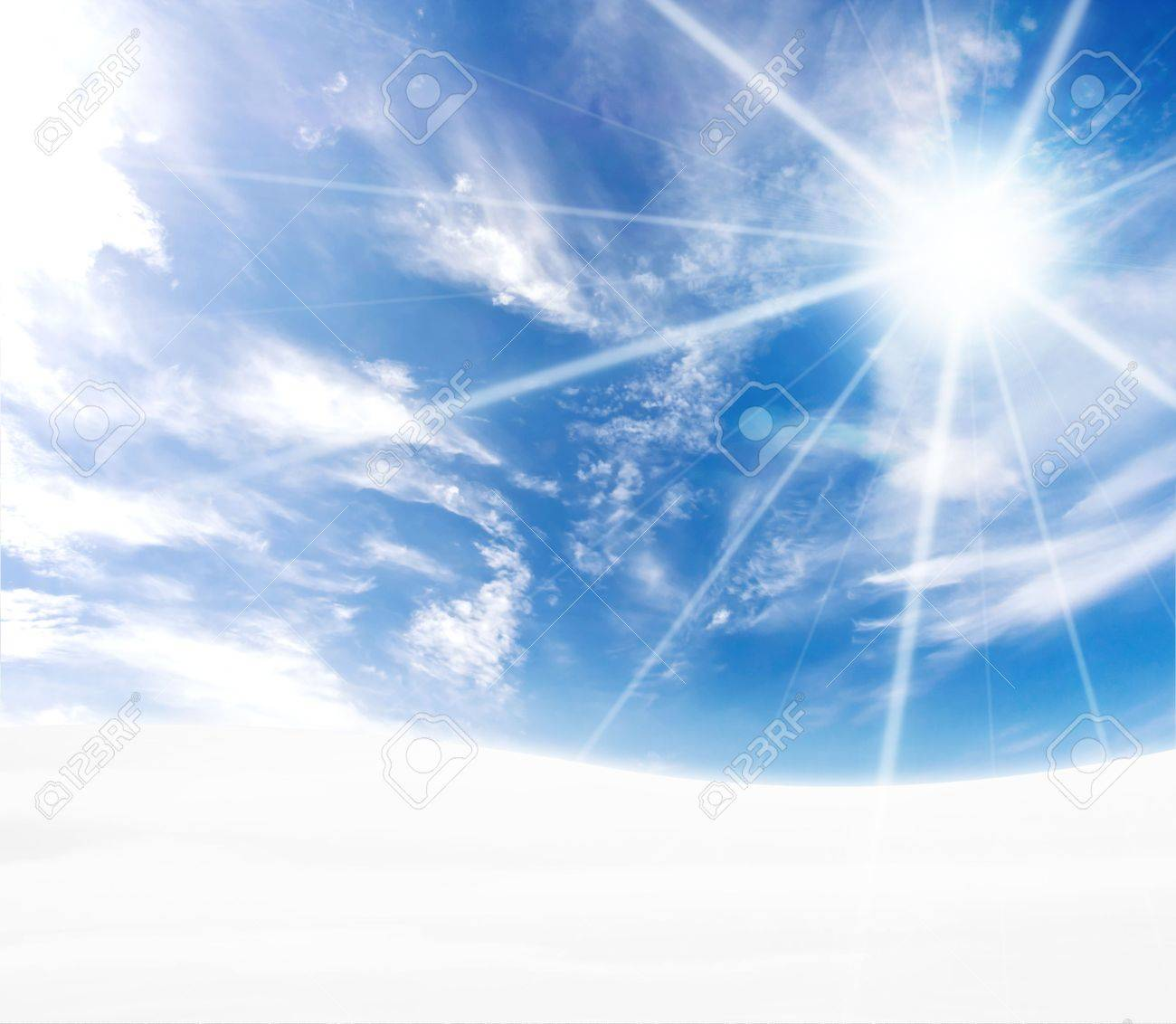 A simple tranquil beautiful S-curved horizon with blue sky and winter snow. Freezing feel with sun flare. - 3939818