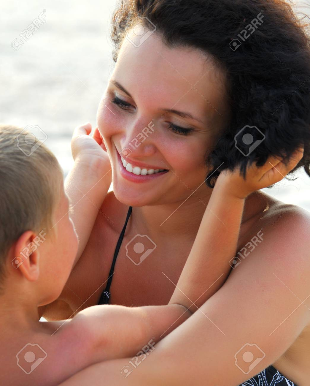 Beautiful young adult mather holding on knees  four years  son Stock Photo - 3709655