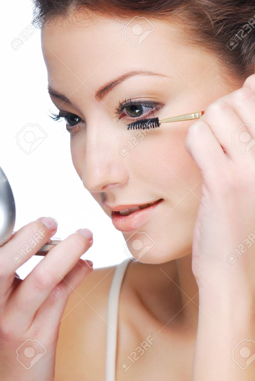 Cute young adult woman  applying maskara - beauty concept Stock Photo - 3971116