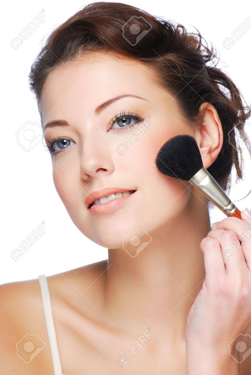 Portrait of attractive young adult woman applying blusher Stock Photo - 3971122