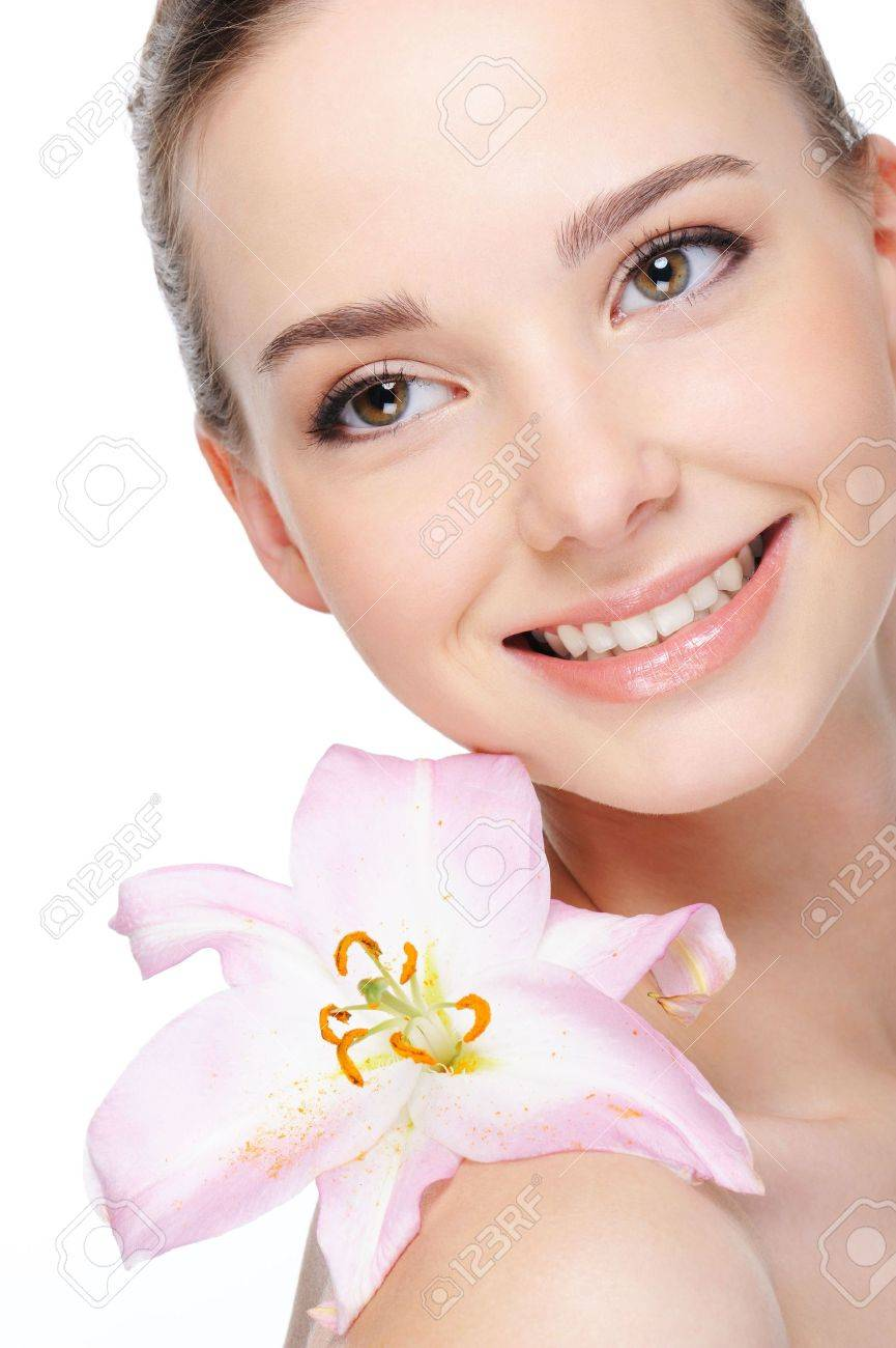 health complexion of beautiful happy laughing young woman with lily on her shoulder Stock Photo - 4593769