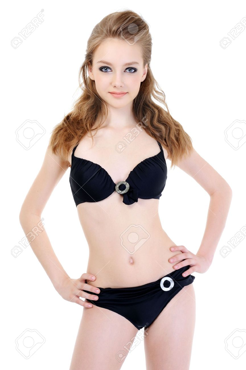 beautiful slender young woman in black sexy lingerie stock photo