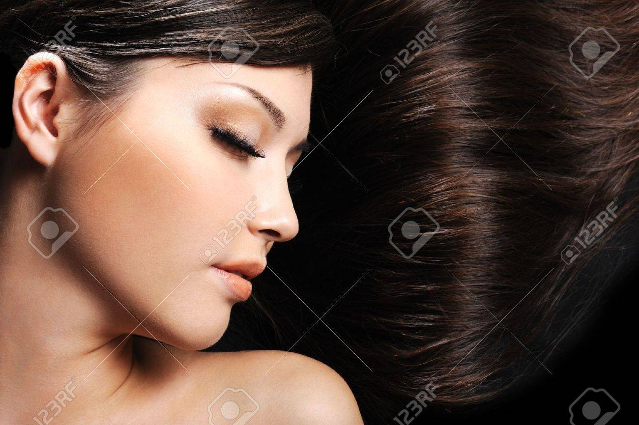 beautiful young female face with long beauty hair as background Stock Photo - 4731832