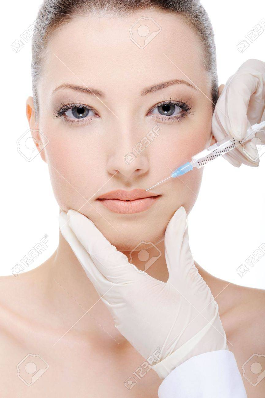beautician giving  injection of botox on female lips Stock Photo - 4863837