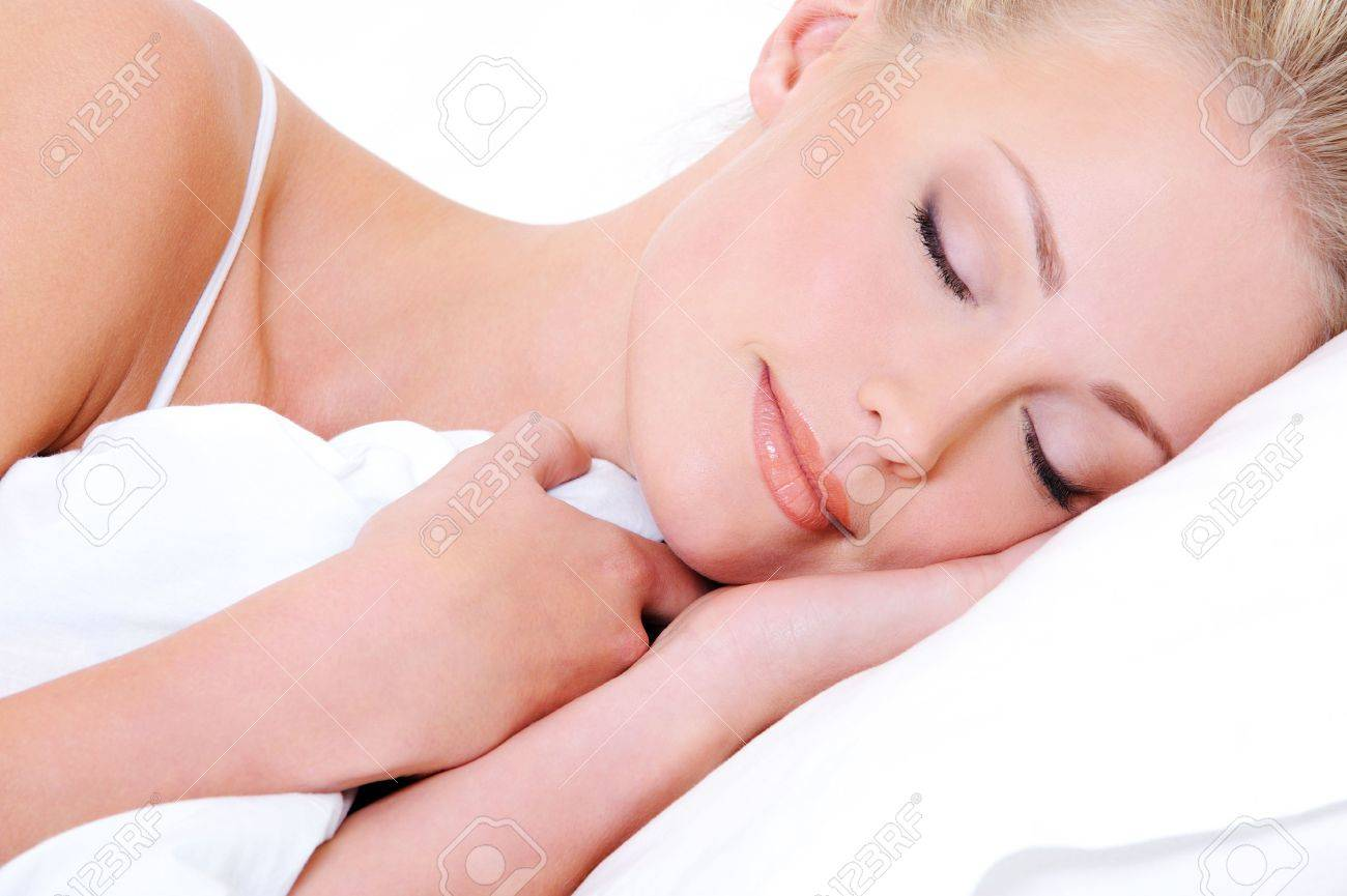 Close-up face of pretty beautiful woman sleeping in the white  pillow Stock Photo - 5661060