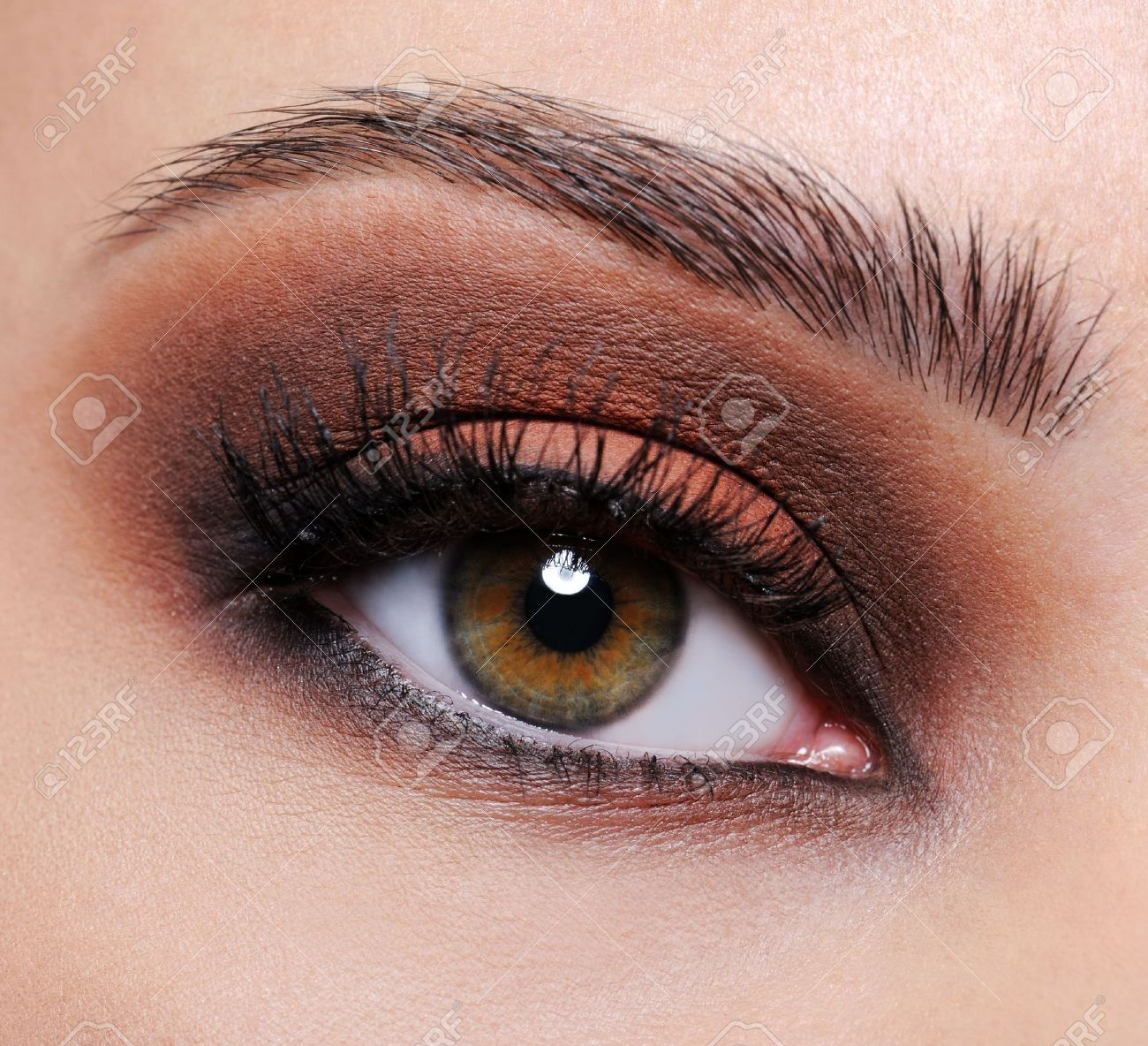 Front view of a close-up female eye with brown eyeshadow make-up Stock Photo - 5671299