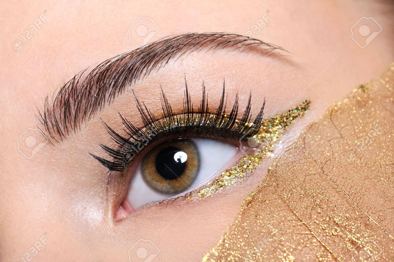 Macro Shot Of A Woman Eye With A False Eyelashes And Yellow Stock