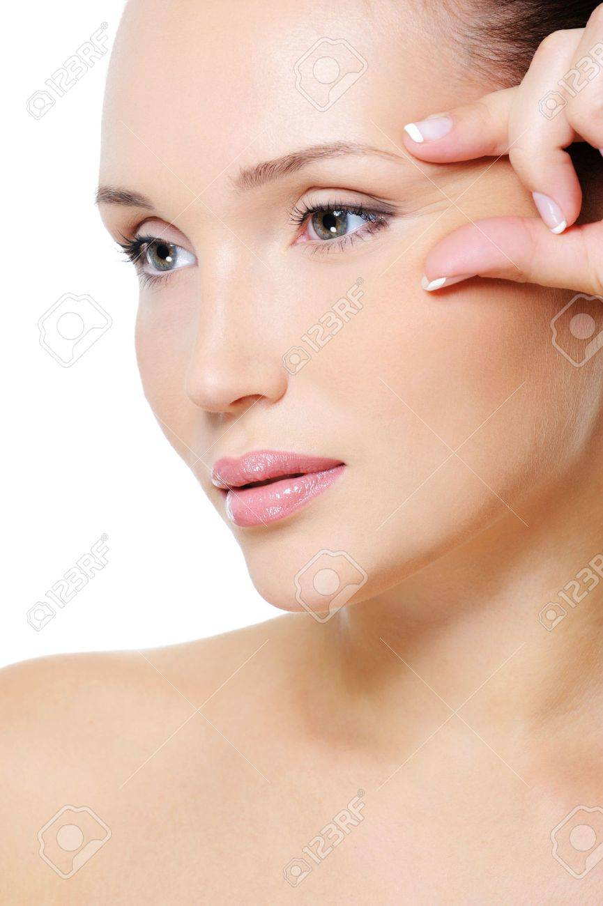 Close-up face of an young beauty  woman squeeze skin near her eye Stock Photo - 5769524