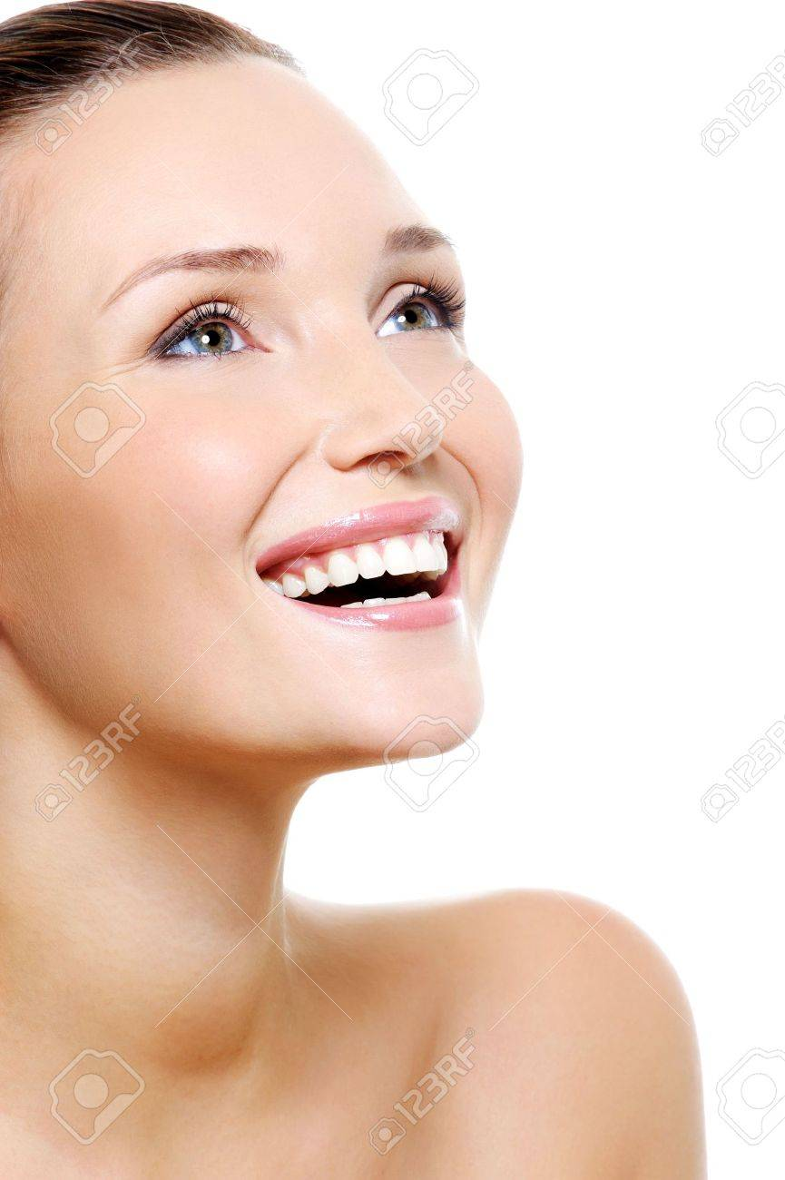 Happy laughing woman portrait with a white healthy teeth - isolated on white - 5769540