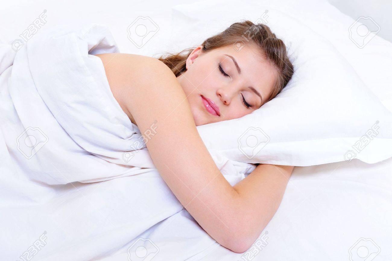 Beautiful young adult woman sleep in her bedroom Stock Photo - 5830693