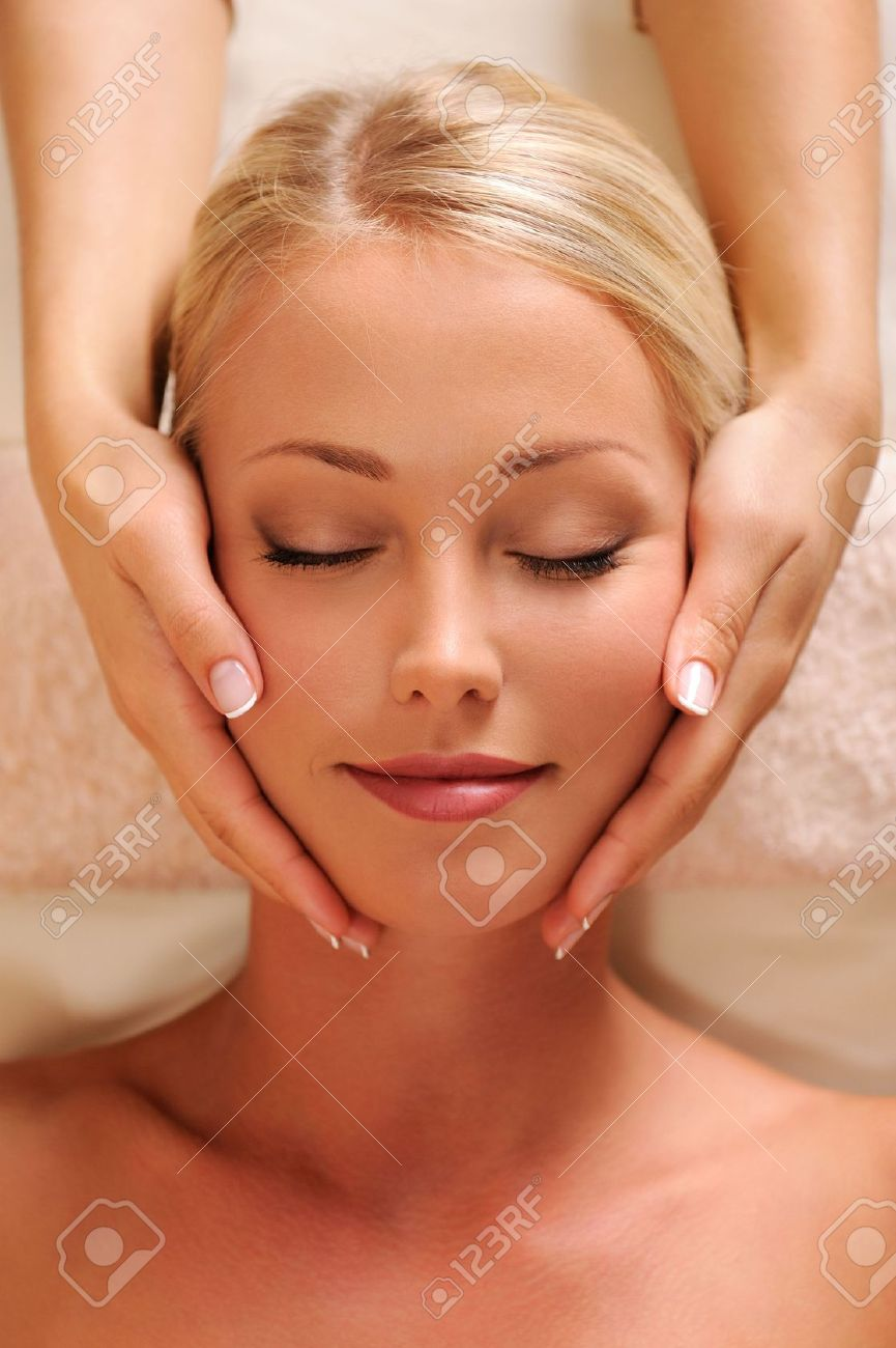 Close-up portrait of a pretty female face getting relaxation massage of head Stock Photo - 5830726