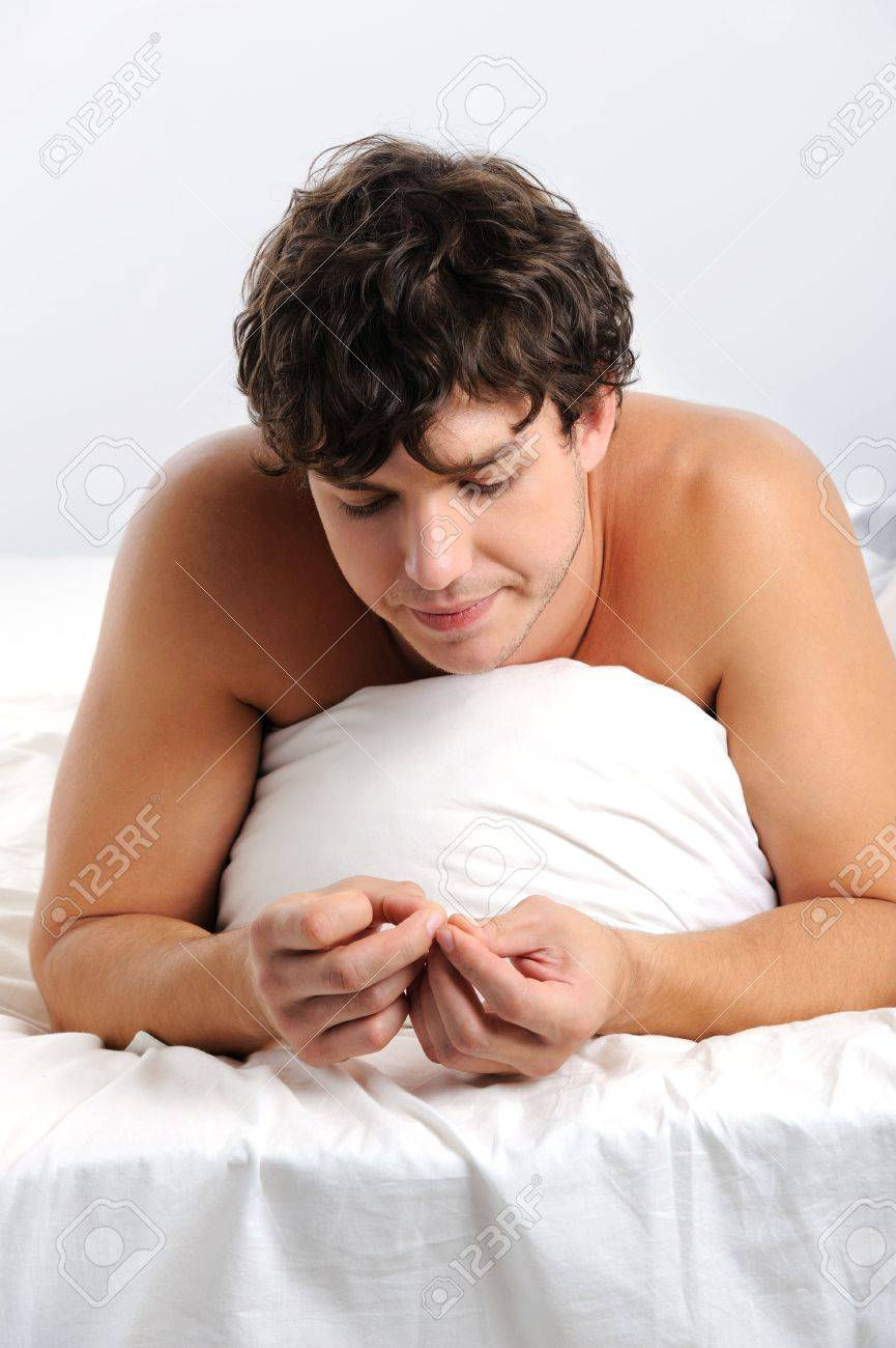 alone sad man lying down in the badroom Stock Photo - 5840511