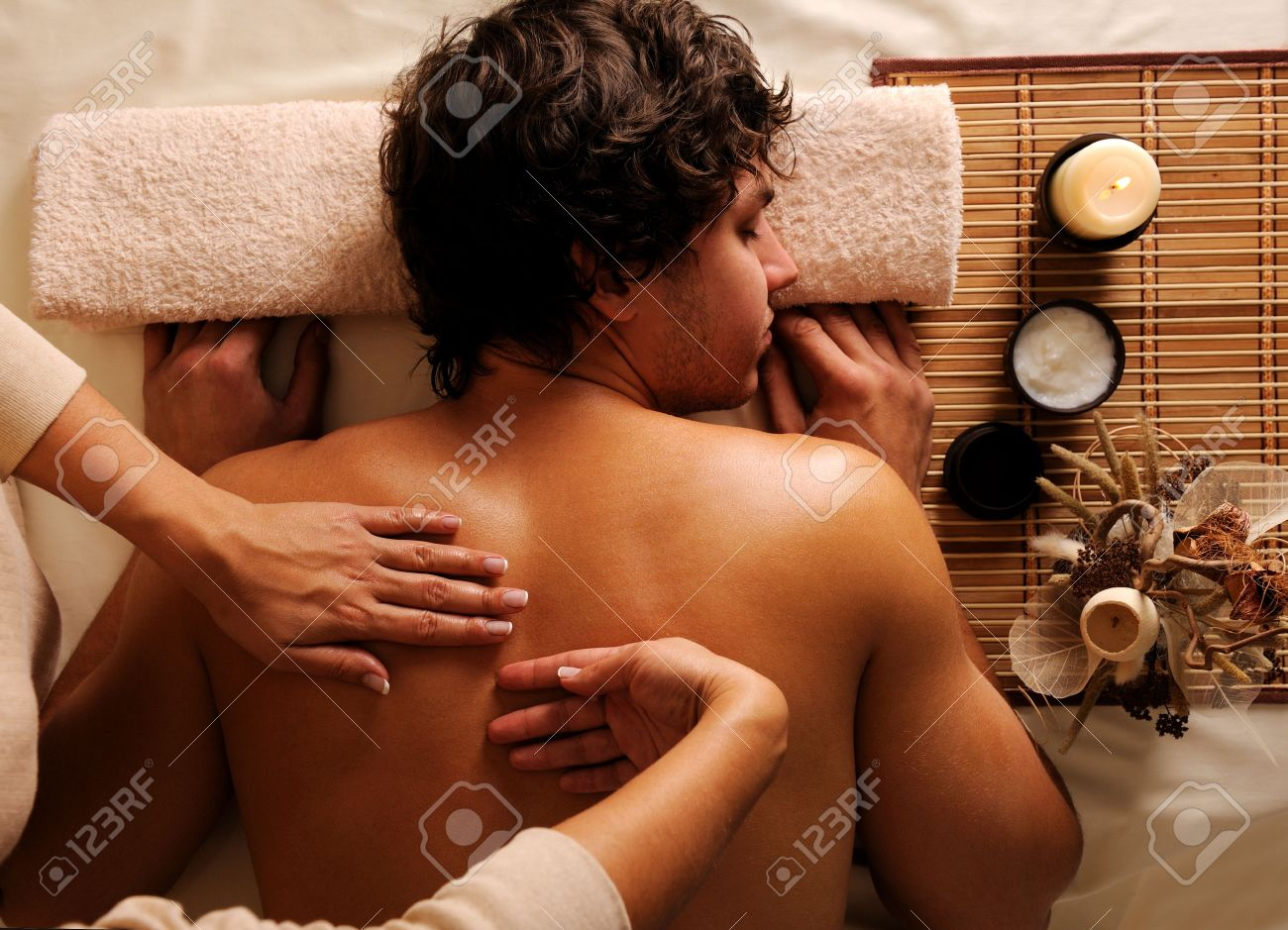The young man on relaxation, recreation, healthy massage in a beauty salon. High angle view. Low key light Stock Photo - 5878903