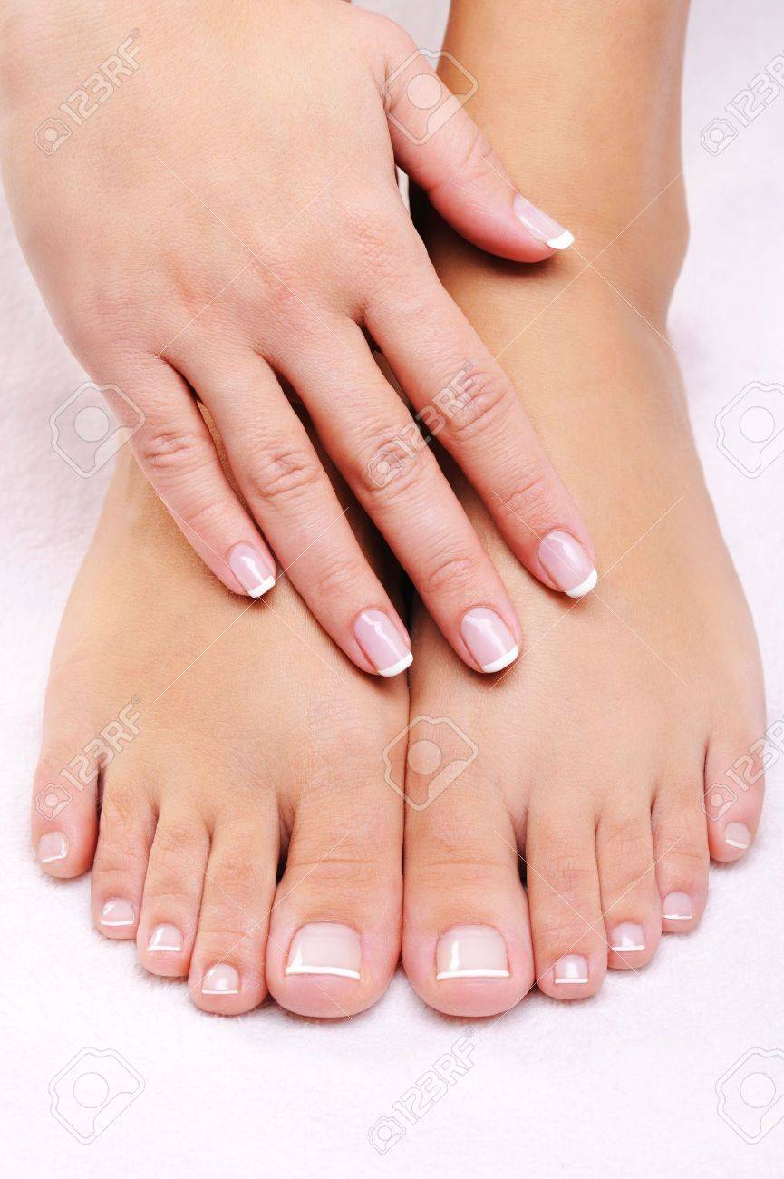 female hands on the well-groomed feet with french pedicure Stock Photo - 5962100