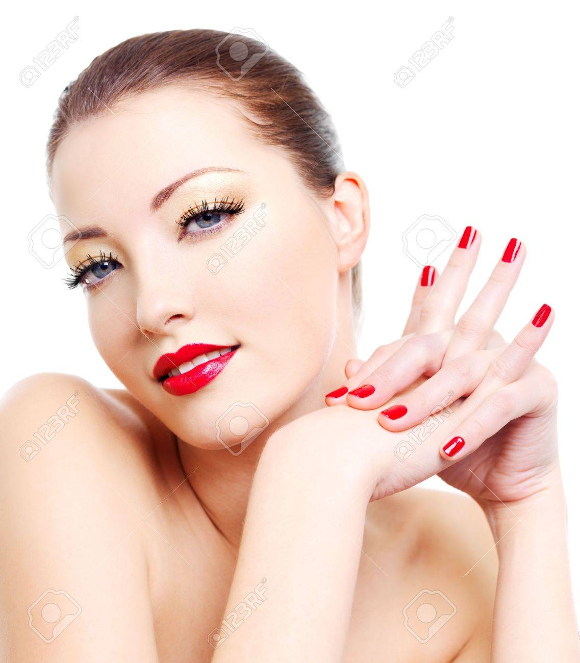 Close-up portrait of sexy young woman with golden glamour make-up and red gloss manicure Stock Photo - 6101717
