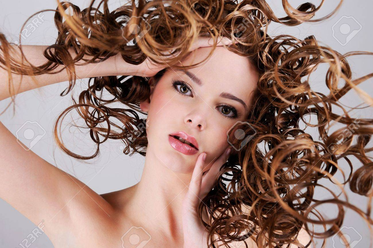 Low angle portrait of the beautiful  woman with  long curly hairs Stock Photo - 6121711
