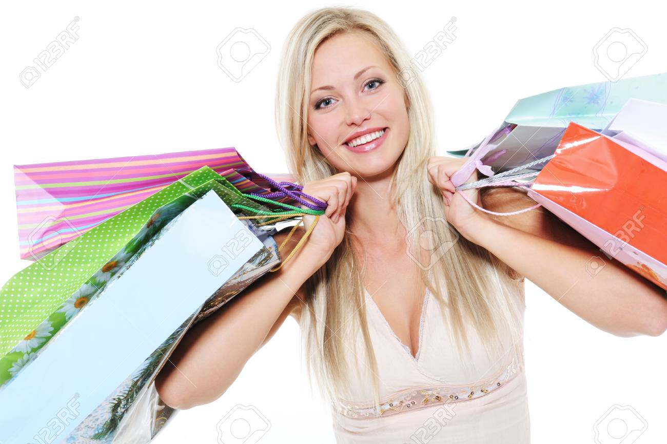 Portrait of happy  beautiful woman with shopping bags - over white background Stock Photo - 6471293