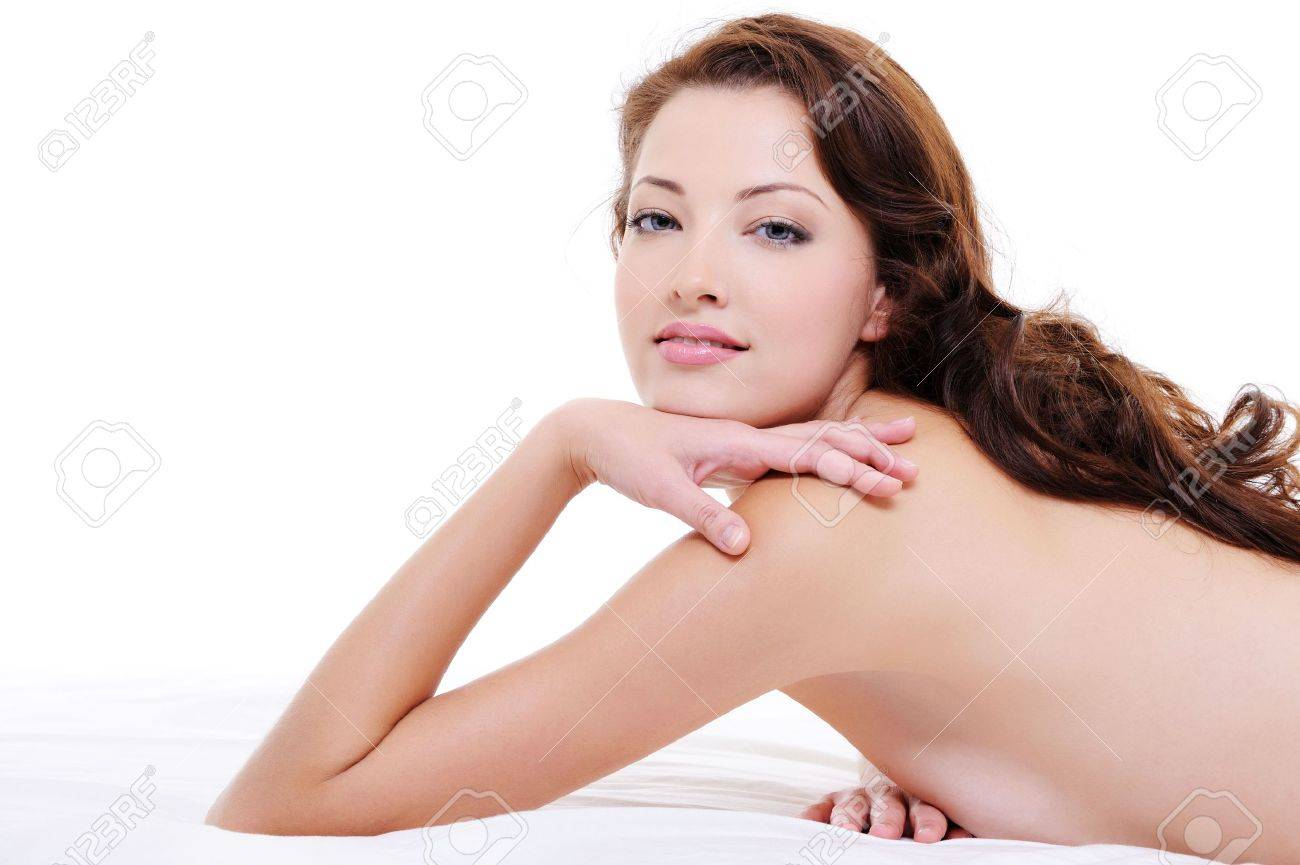 Portrait of a  pretty red hair woman with nude body lying on white bed Stock Photo - 6477304