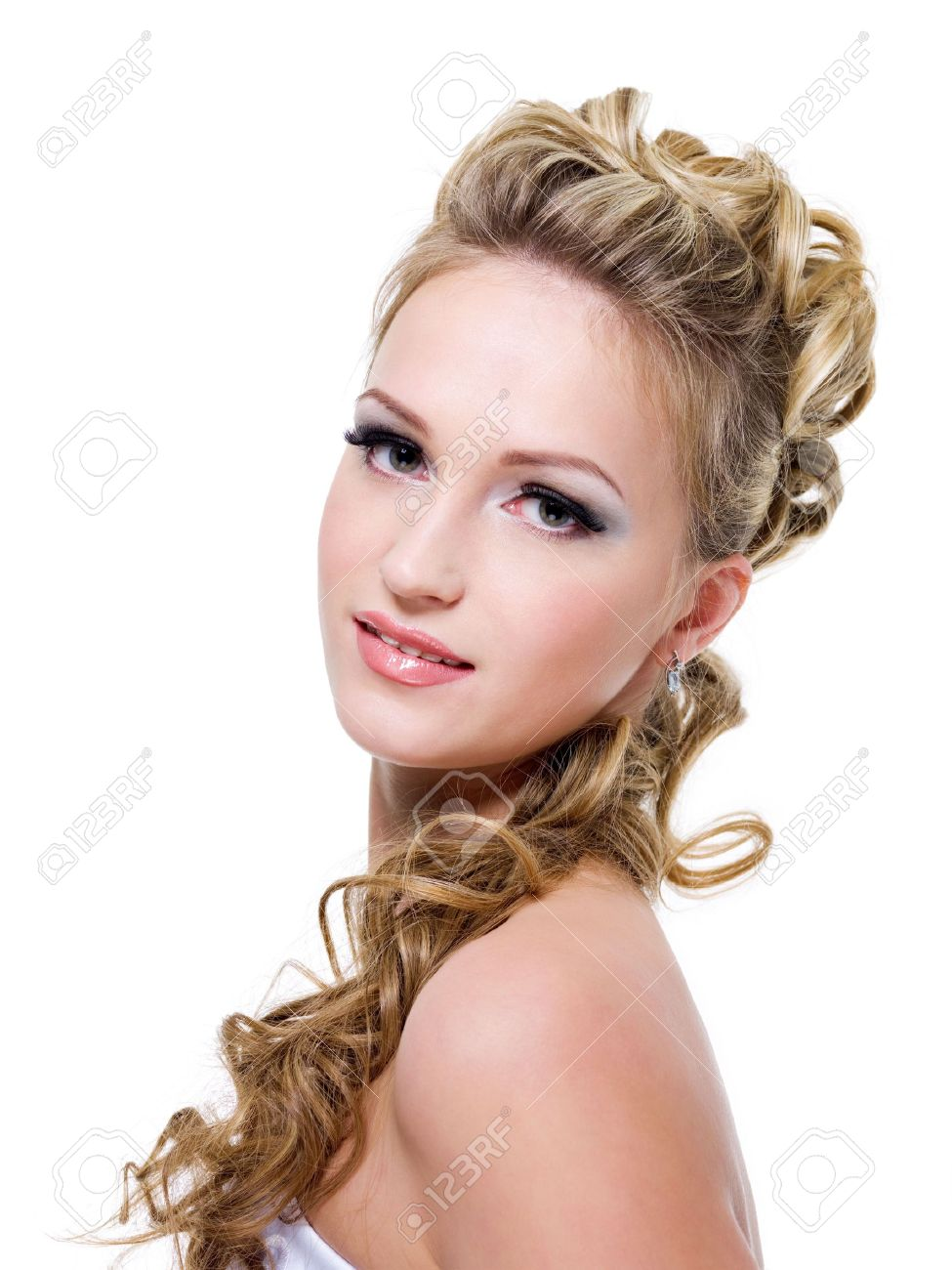 Attractive young bride with beautiful wedding hairstyle - isolated on white Stock Photo - 6582085