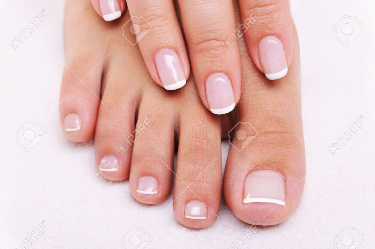 Beauty Nails Concept Of A Female Hand And Feet With Beautiful ...