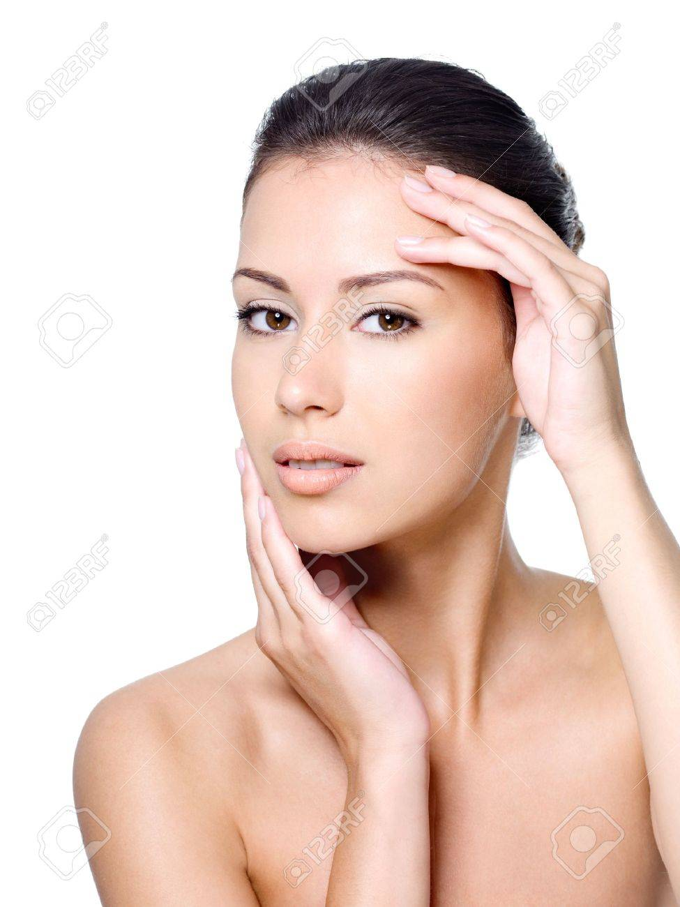 Beauty portrait of young woman with healthy skin on a face - close-up Stock Photo - 7416224