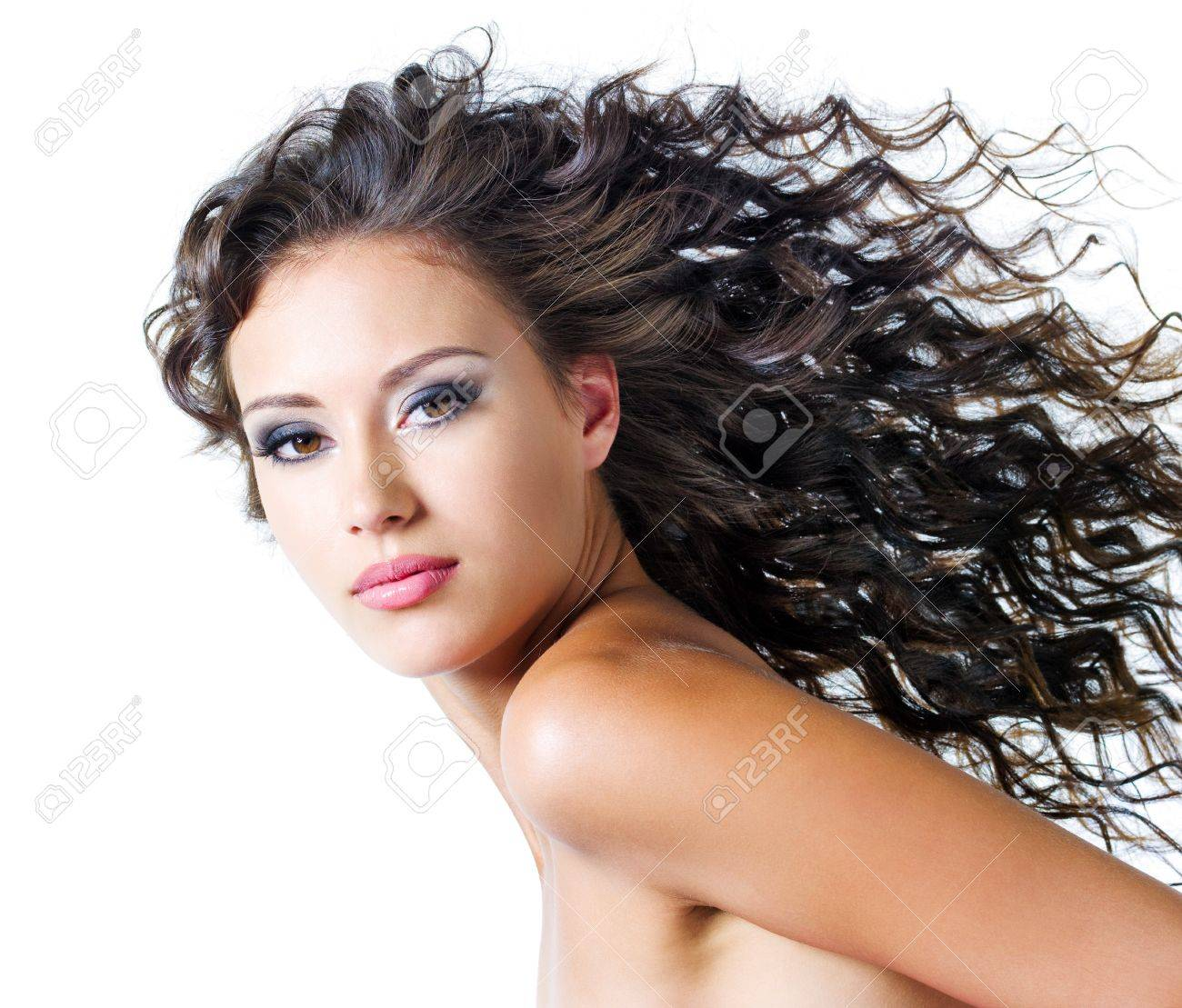 Face of  a beautiful young woman with brown long ringlets hairs and dark fashion make up. Isolated on white Stock Photo - 7506942