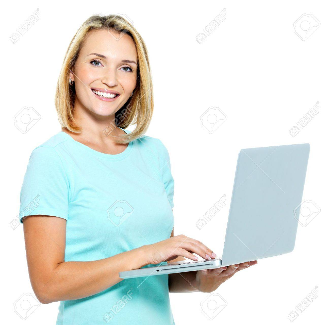 Happy woman typing  on the laptop - isolated on white Stock Photo - 7953477