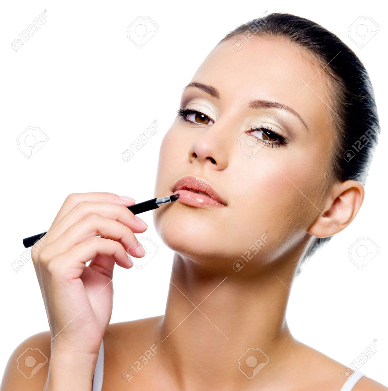 beauty woman applying lipstick on lips with brush - isolated Stock Photo - 8040953