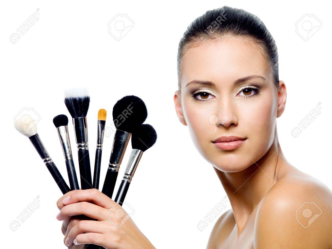 Portrait of beautiful woman with makeup brushes - isolated on white Stock Photo - 8040980