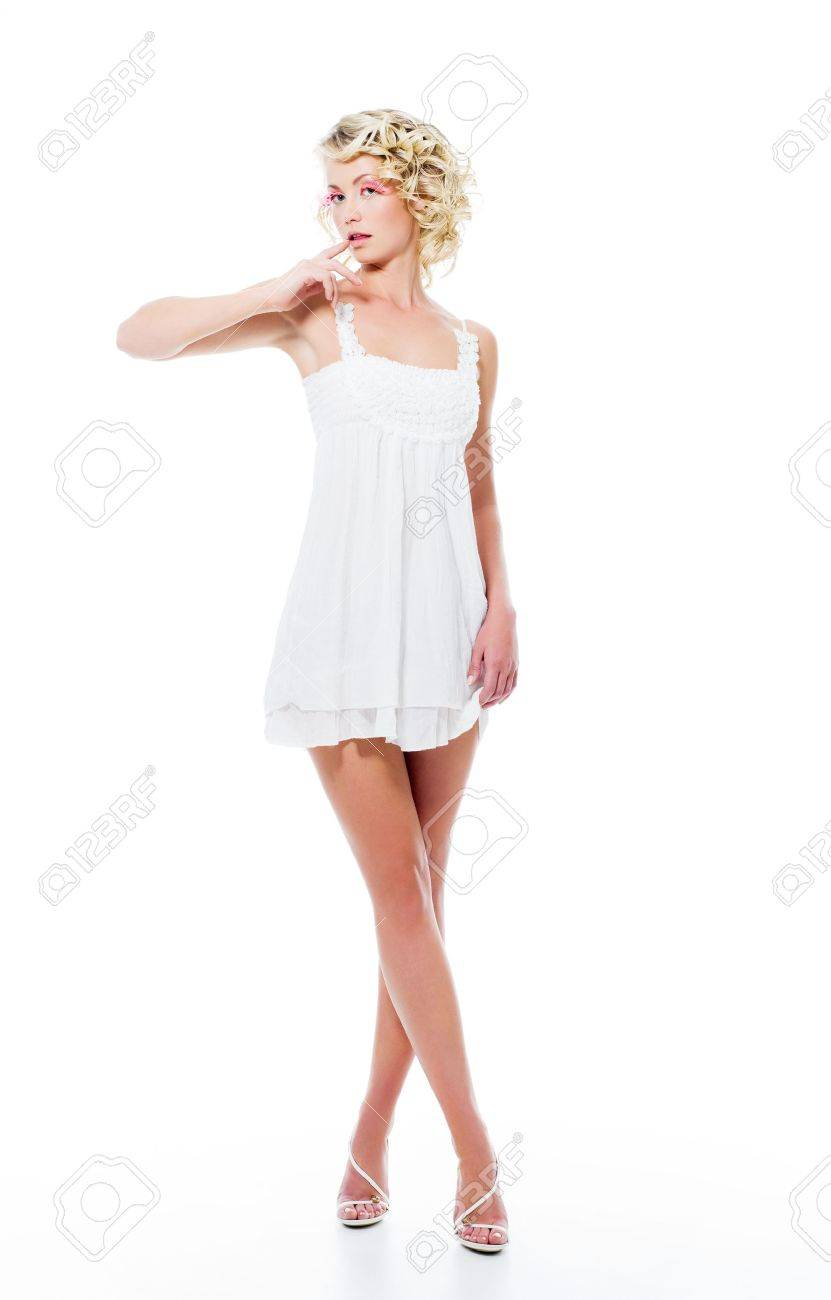 Fashion sensuality attractive woman with modern white dress posing in studio Stock Photo - 8041226