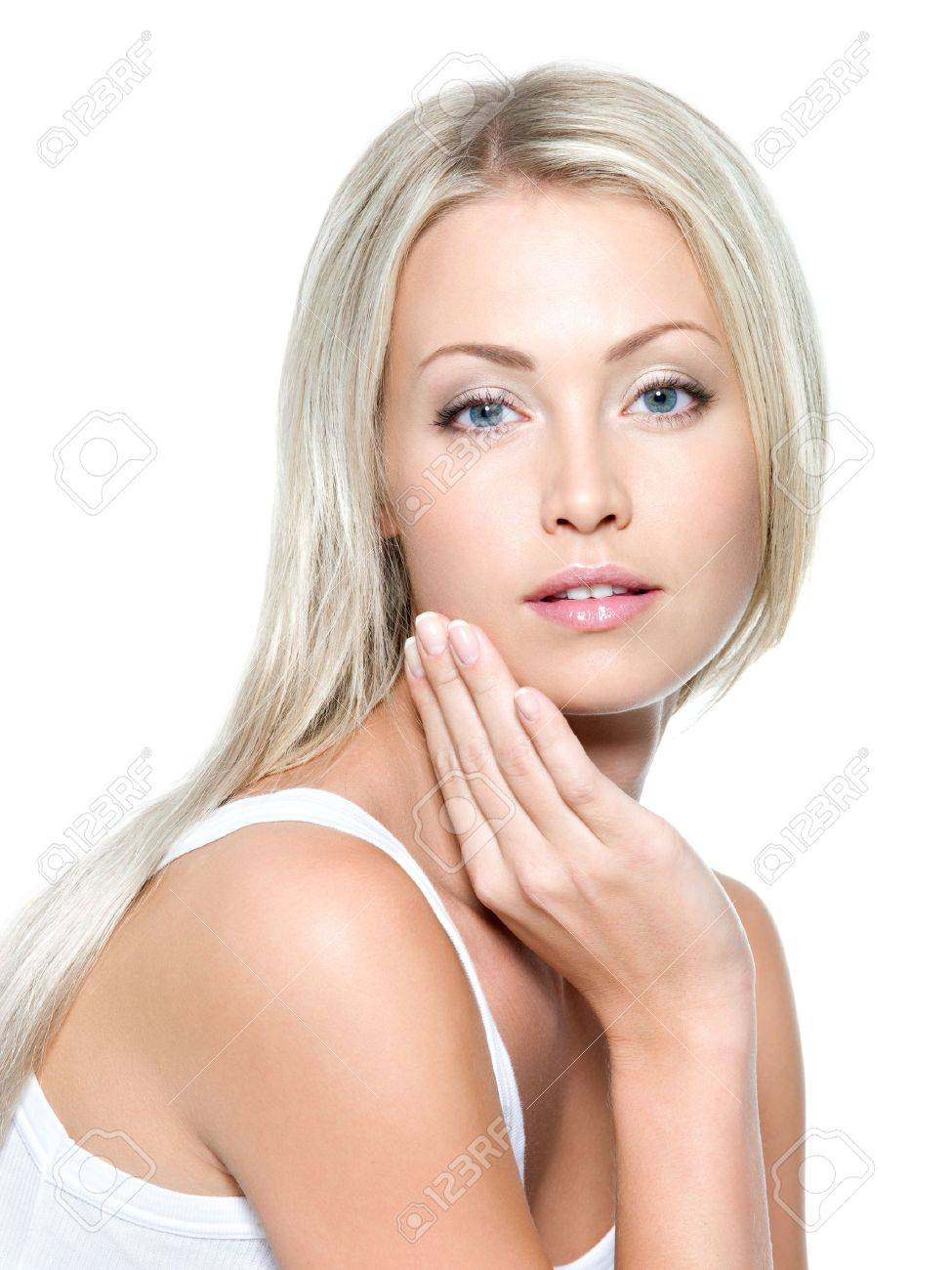 Beautiful sexy woman touching her health face - isolated Stock Photo - 8041264