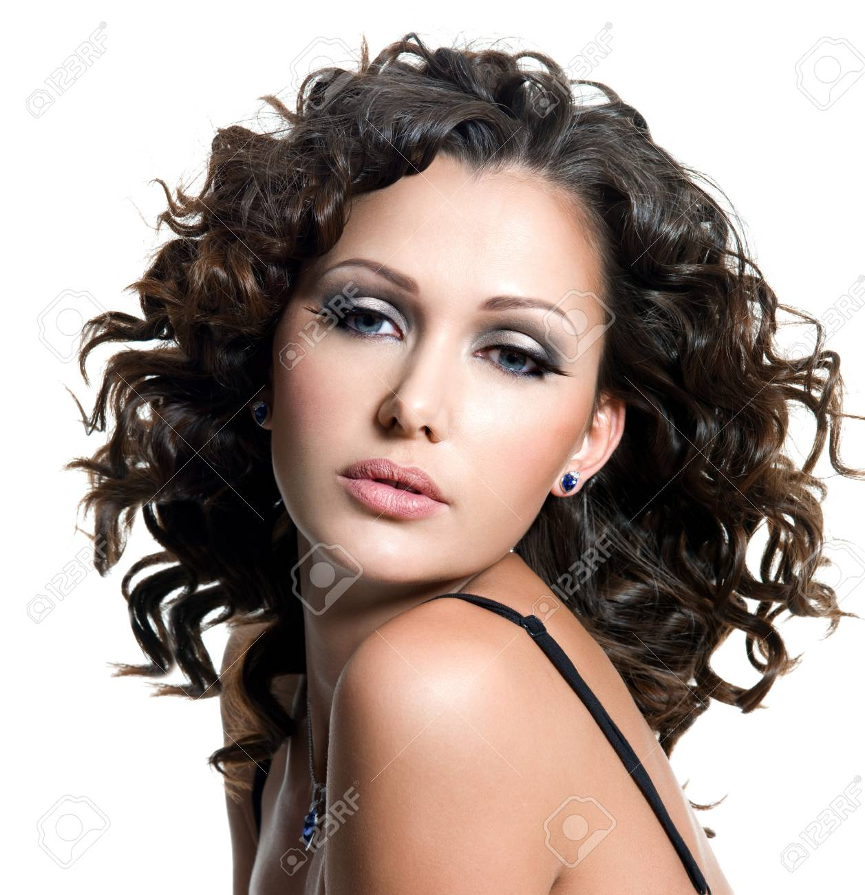 face of beautiful young woman with fashion makeup and curly hair. Isolated on white Stock Photo - 8078603