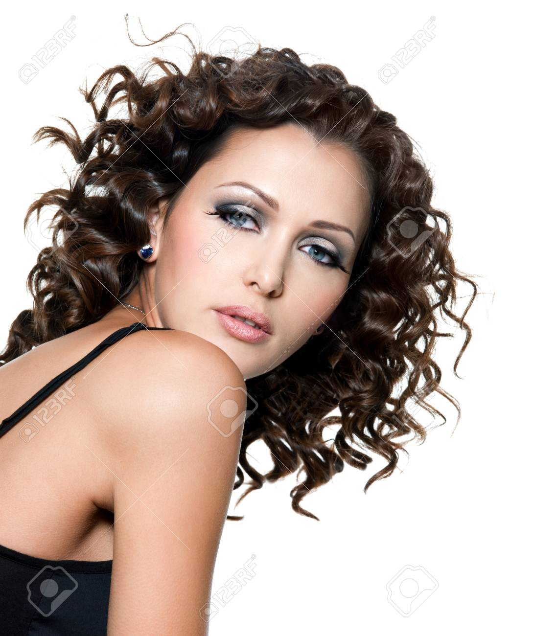 Beautiful face of young woman with fashion makeup and curly hair. White backround Stock Photo - 8078602