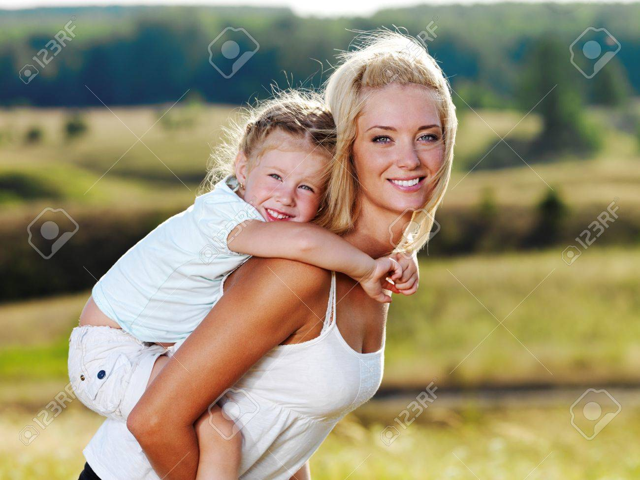 Beautiful Portrait of  mother and little pretty girl outdoors Stock Photo - 8078618