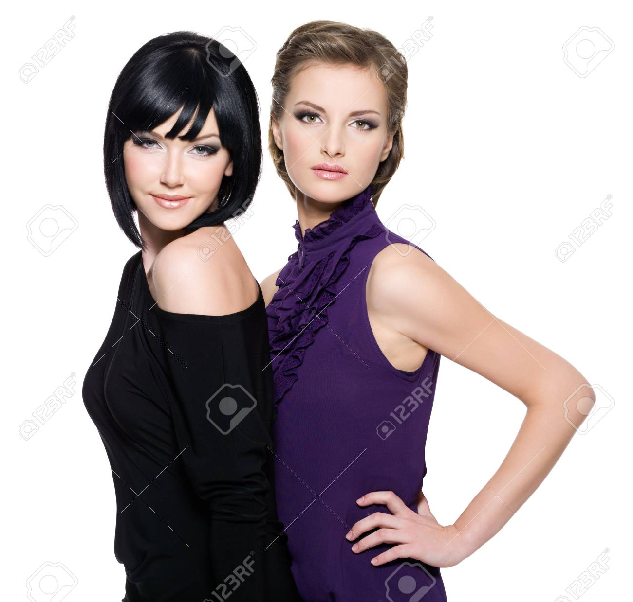 Two beautiful  glamour women standing together over white background Stock Photo - 8440501