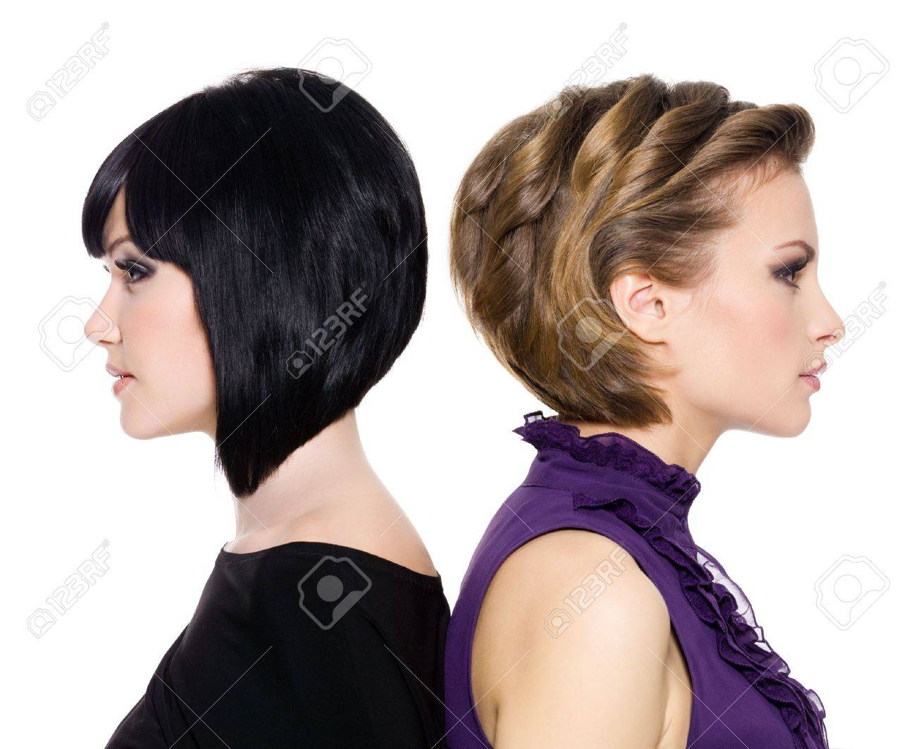 profile faces  of  two attractive adult girls standing back to back Stock Photo - 8440498