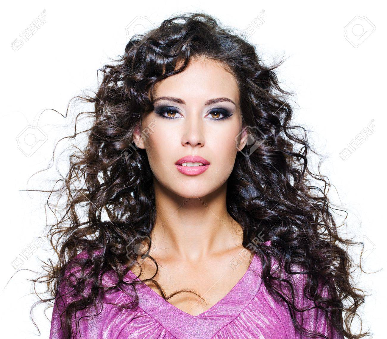 Face of  a beautiful young woman with brown long ringlets hairs and dark fashion make up. Isolated on white Stock Photo - 8802756