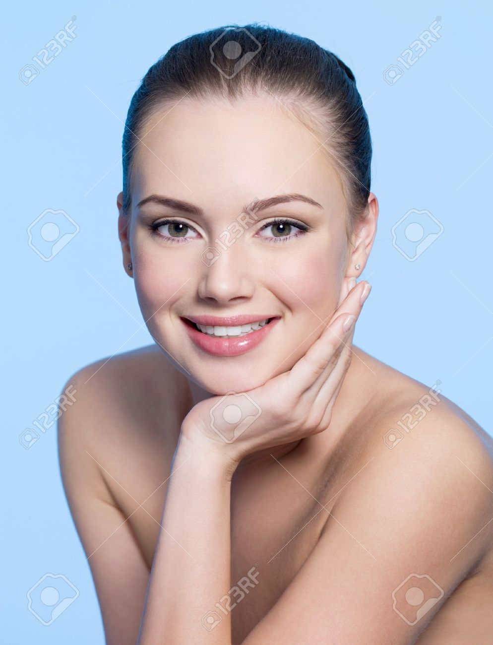 Happy beautiful teen girl face with clean healthy skin - blue background - 8928580-Happy-beautiful-teen-girl-face-with-clean-healthy-skin-blue-background-Stock-Photo