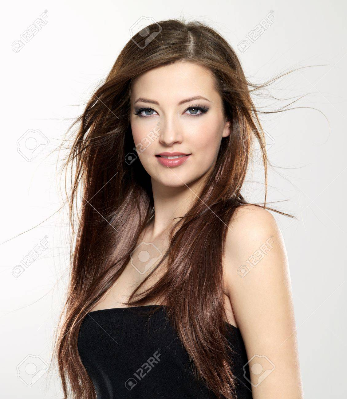 portrait of  beautiful sexy young woman with  long straight hair blowing on wind Stock Photo - 9002514