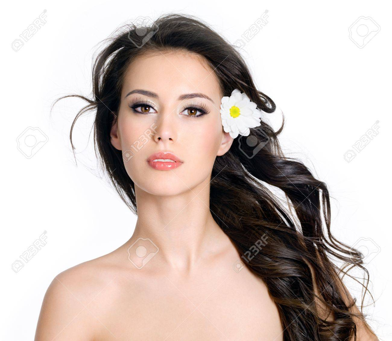 Beautiful sensuality glamour woman with clean skin and flowers in her long hair - white background Stock Photo - 9002547