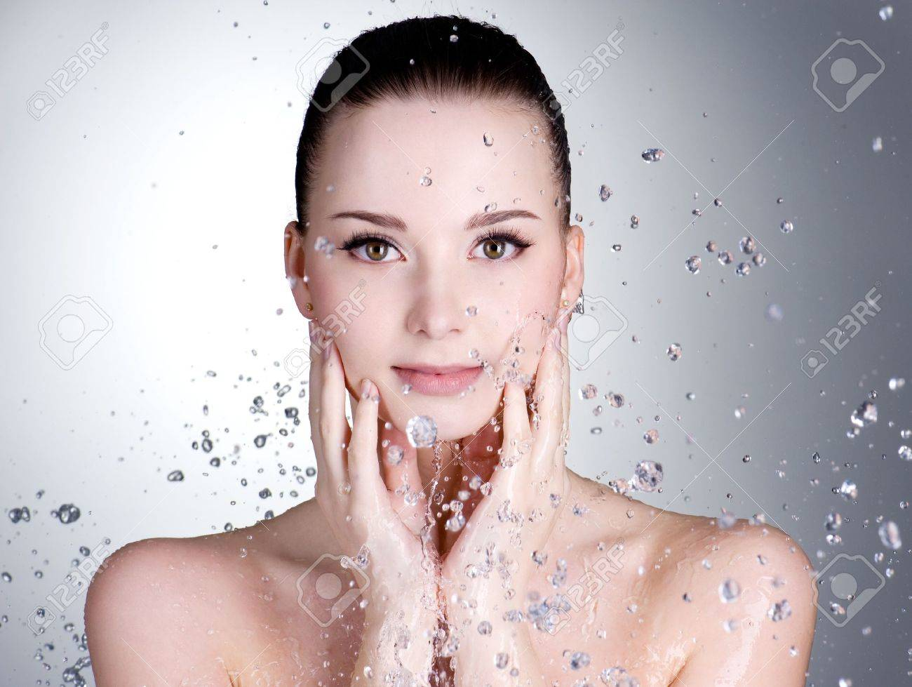 Portrait of beautiful young woman with drops of water around her face - horizontal Stock Photo - 9195347