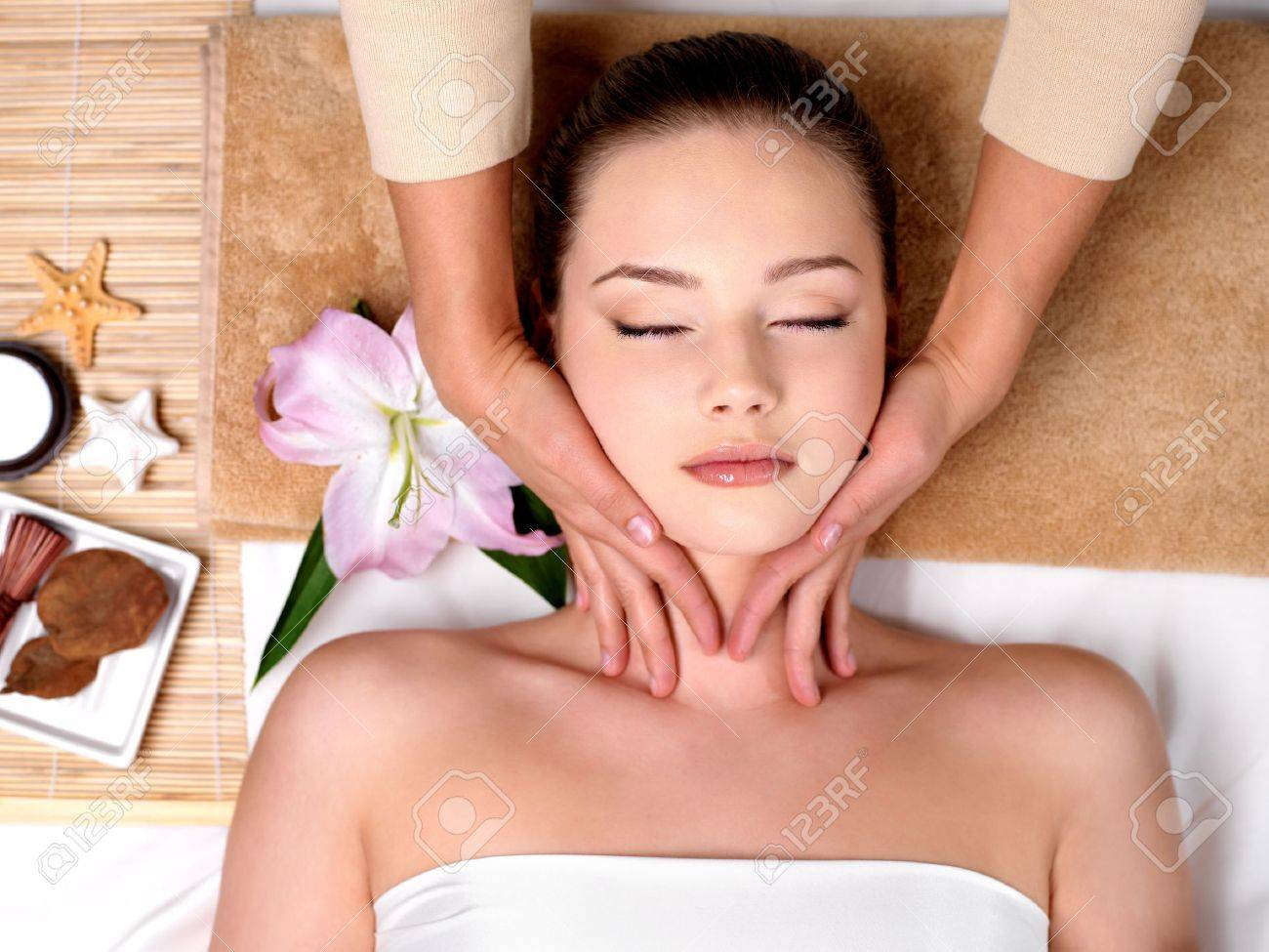 Beautiful young girl getting massage for neck in spa salon - indoors Stock Photo - 9267834
