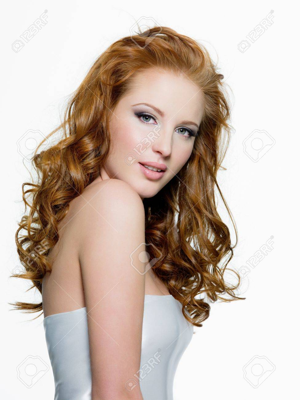 Beautiful young red-haired woman with long beauty curly-headed hairs - isolated on white Stock Photo - 10802241