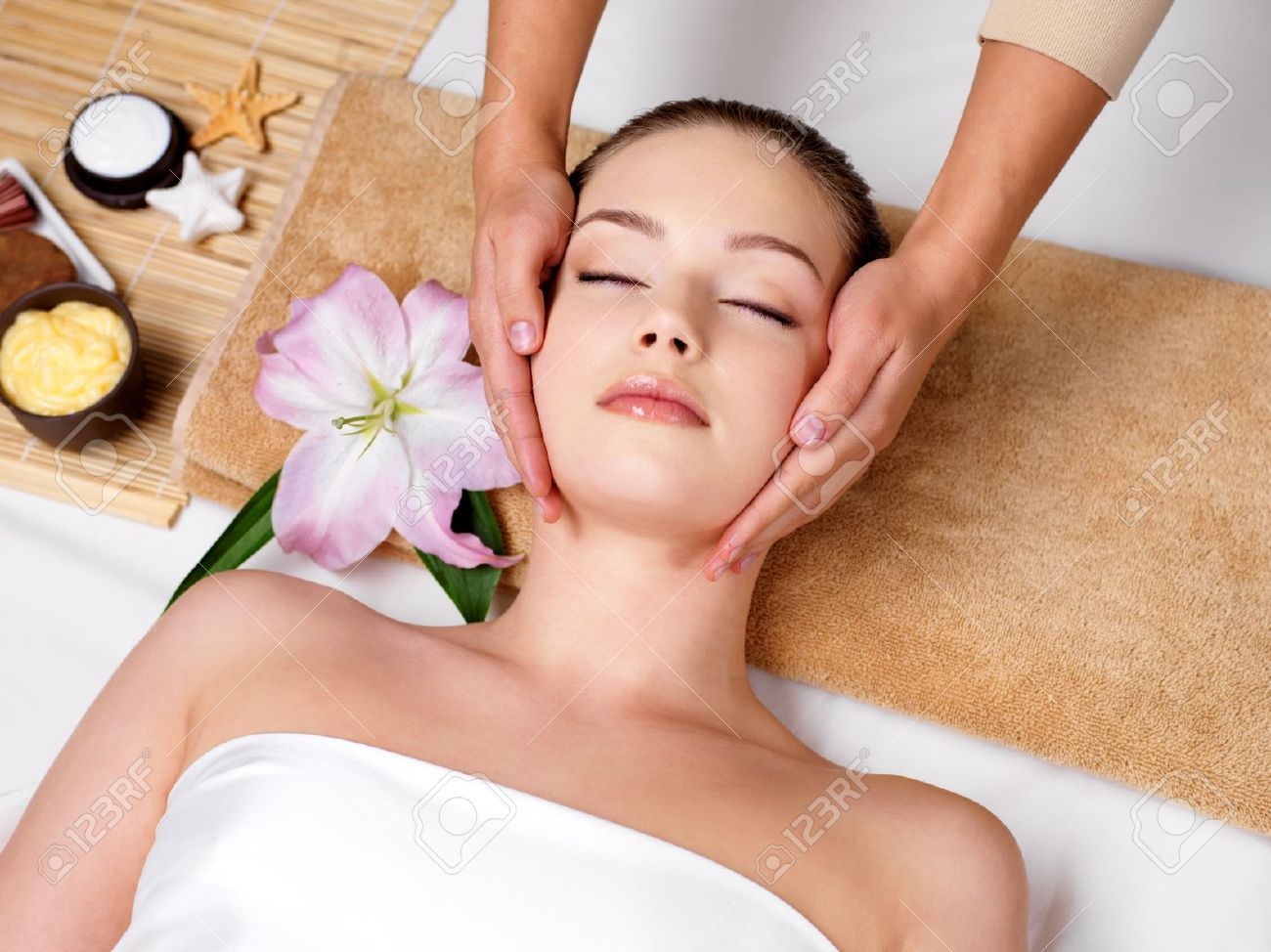 Relaxing Beautiful Woman Having A Massage For Her Skin A Face