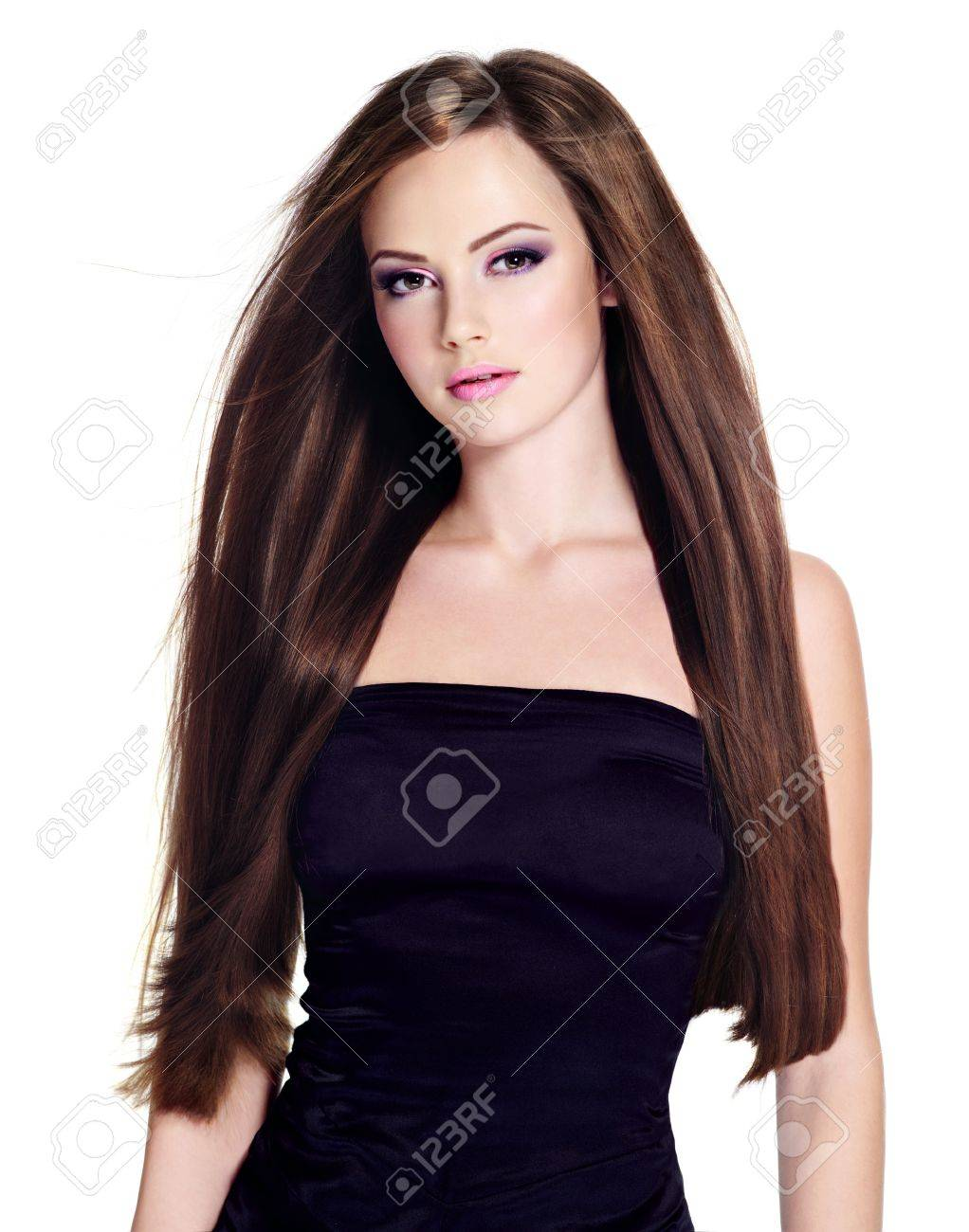 Beautiful young woman with  long straight hair, posing on white background Stock Photo - 12862367