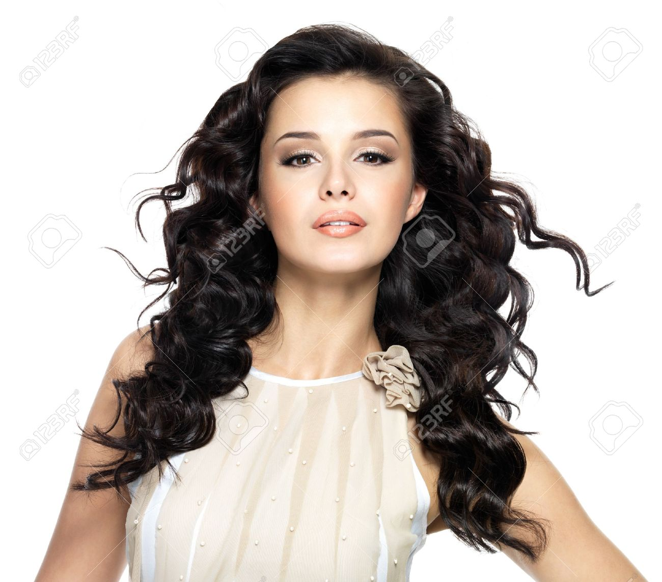 Beautiful brunette woman with beauty long curly hair. Fashion model with wavy hairstyle Stock Photo - 16469075