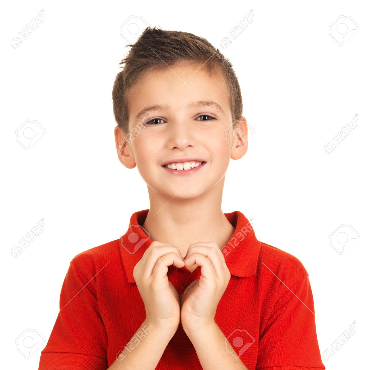 Portrait of happy boy with a heart shape isolated on white background Stock Photo - 16578422
